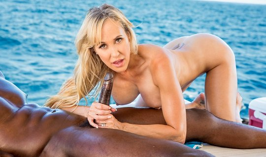 Sexy blonde and black man on a yacht